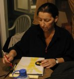 Photo of Natasha painting taken by taken by Kara Wilde Kara@creativehealing.org