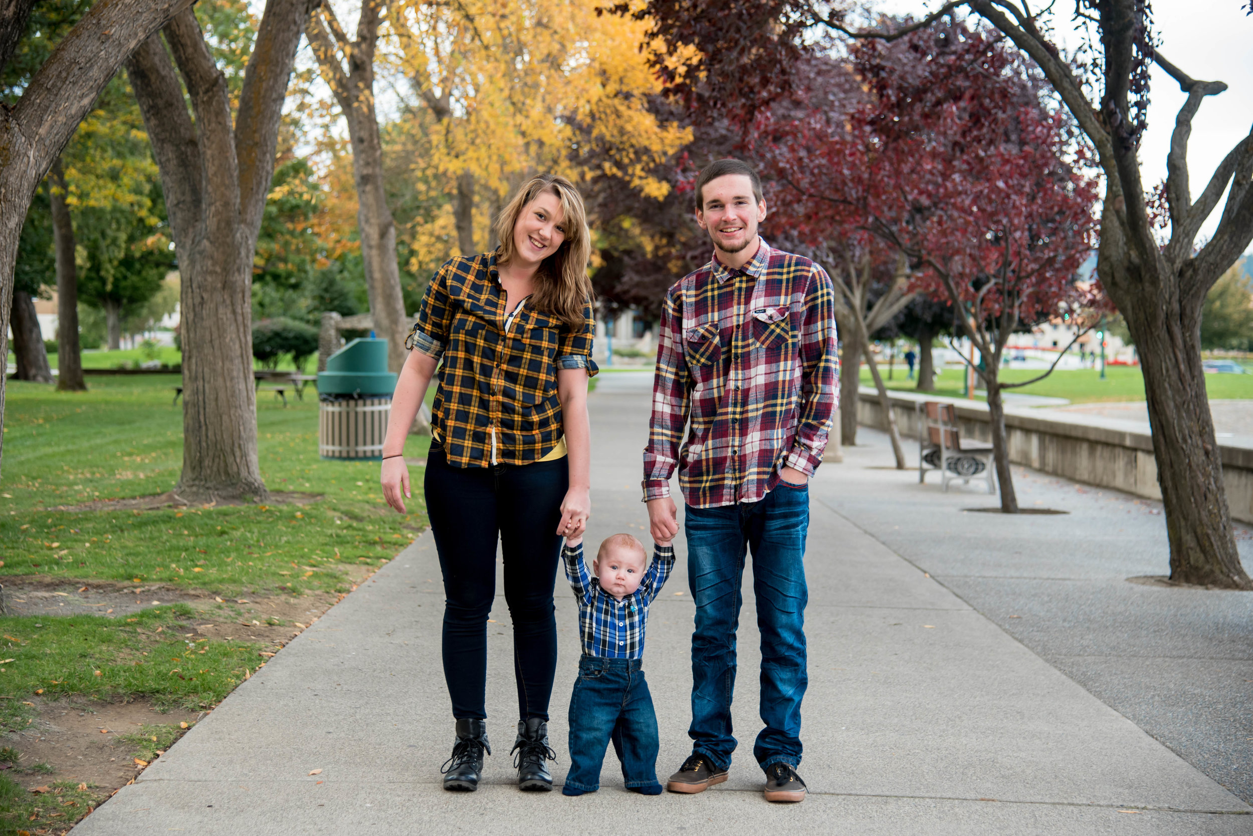 Happy family holds babies hands in Coeur d' Alene Idaho