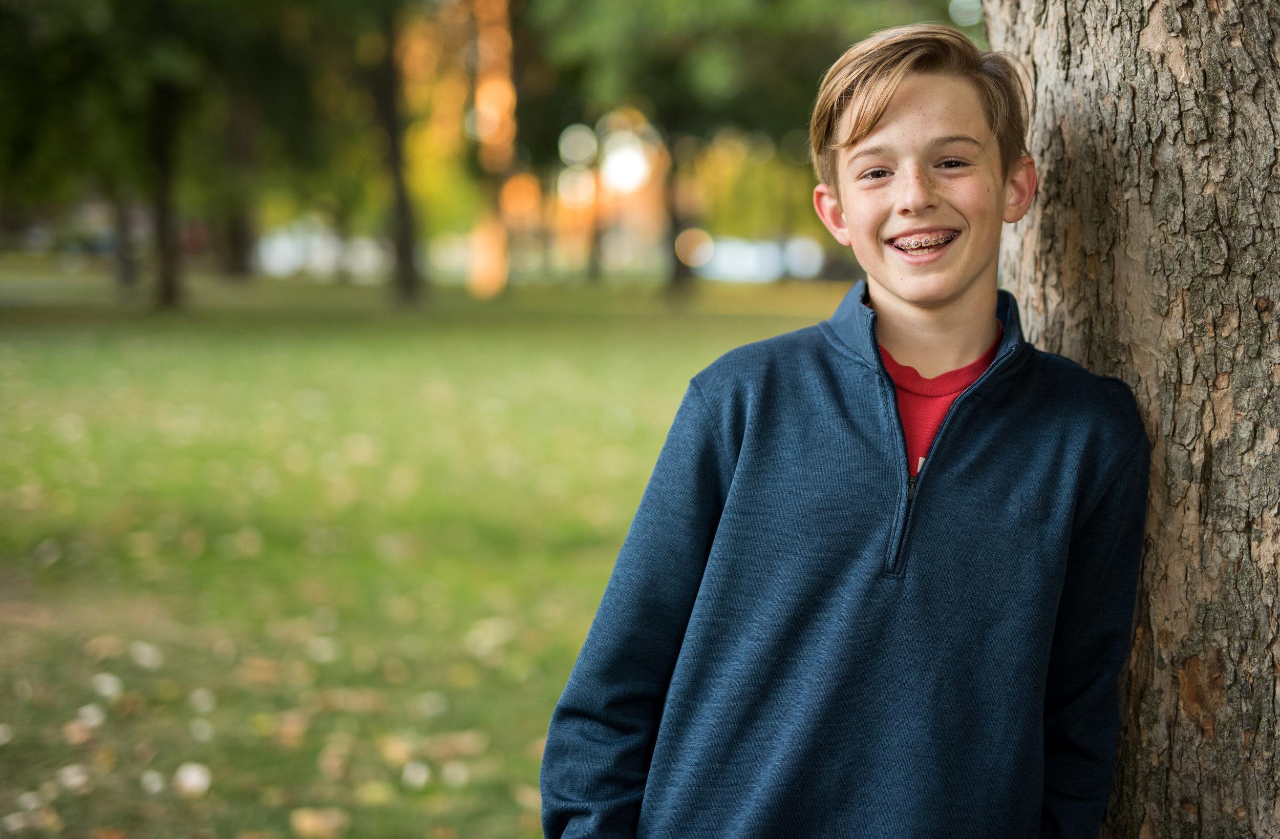 kid smiling at camera coeur d alene idaho