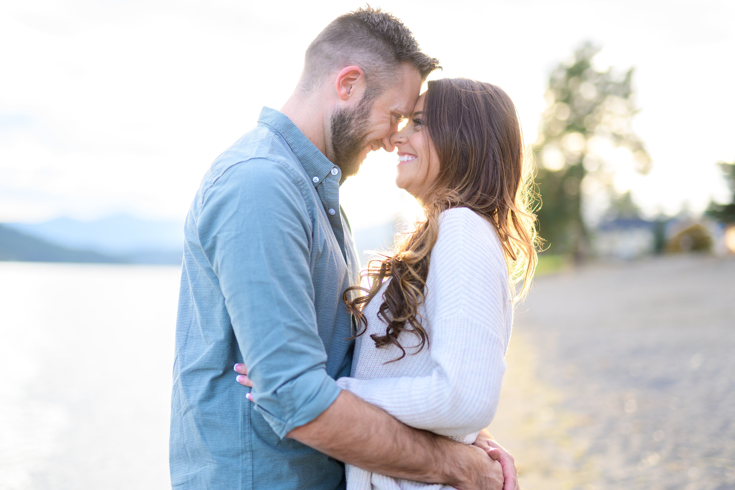 engaged couple smiling in coeur d alene idaho