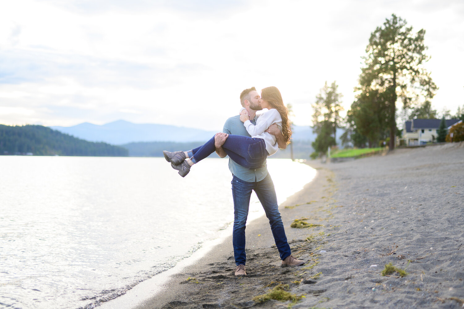 engaged couple kissing in coeur d alene idaho