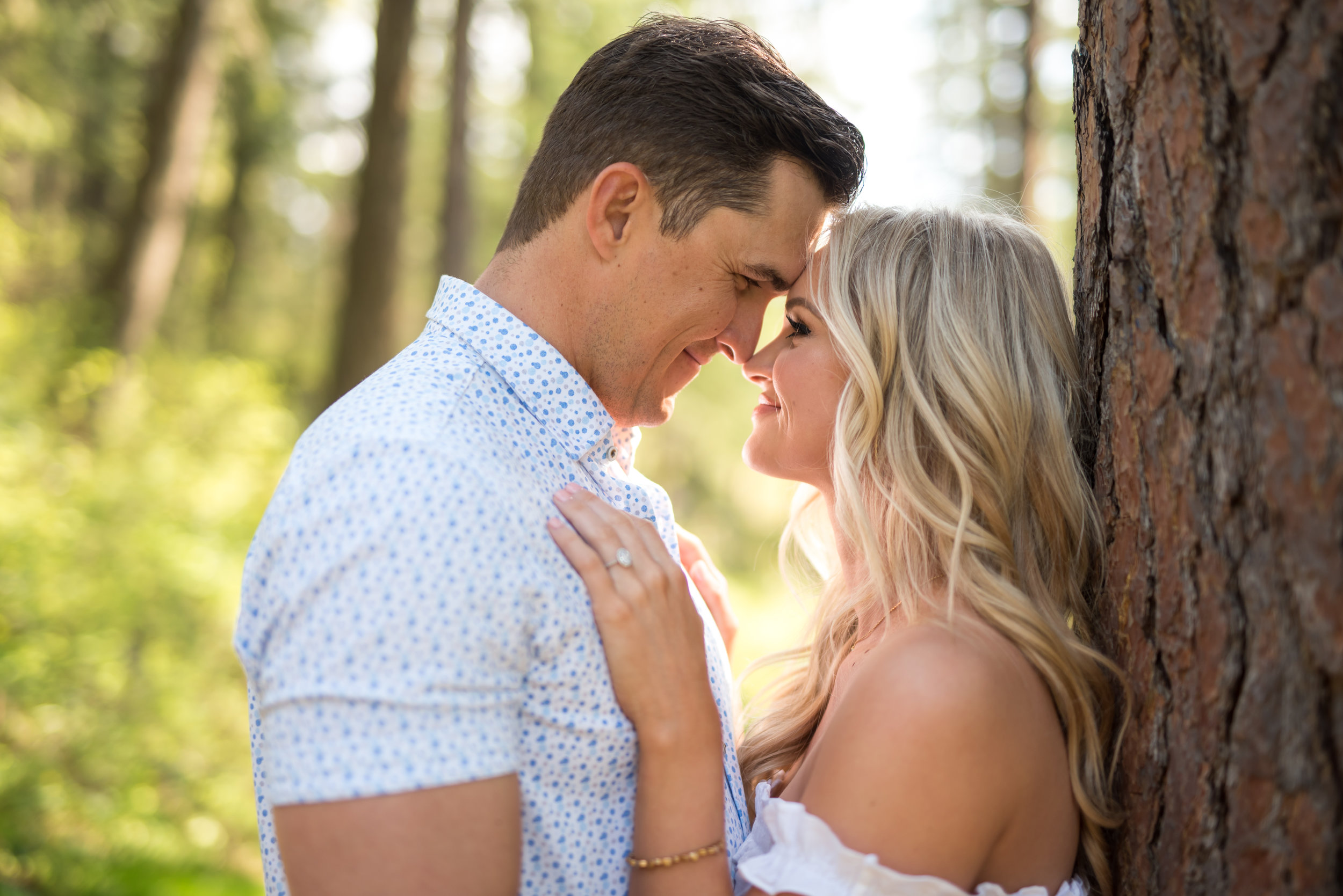 engaged couple looking in coeur d alene idaho