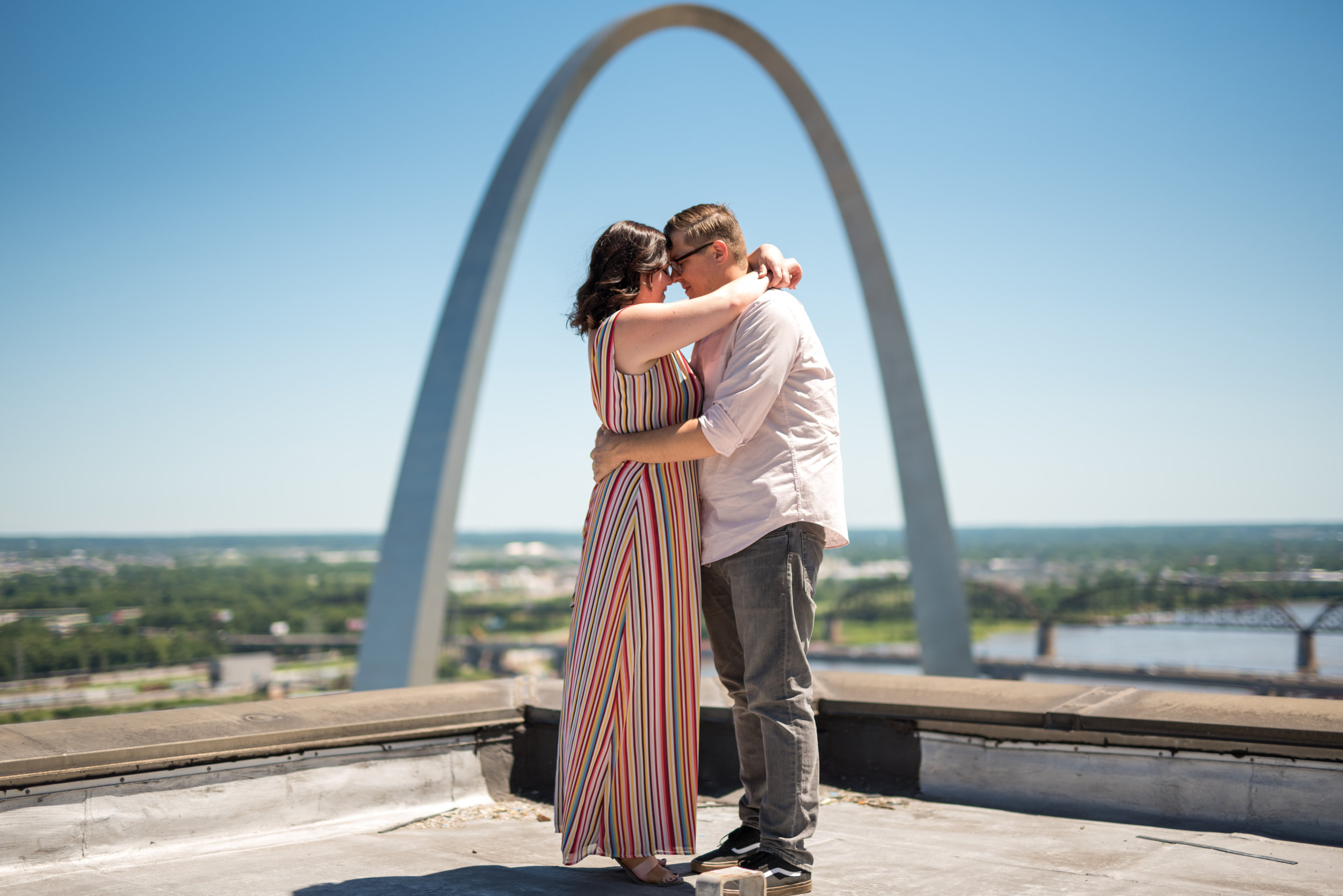 engaged couple hugging in st louis missouri