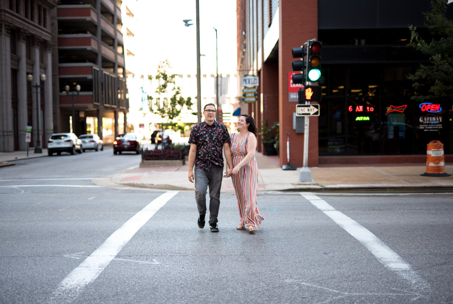 engaged couple walking in st louis missouri