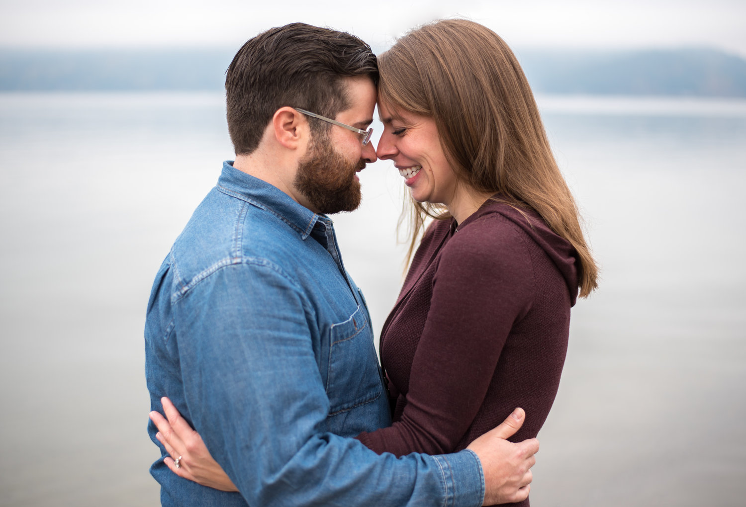 engaged couple hugging in coeur d alene idaho