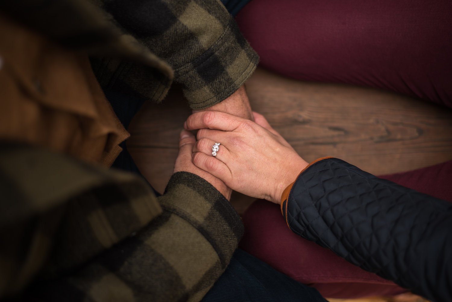 engaged couple holding hands in coeur d alene idaho