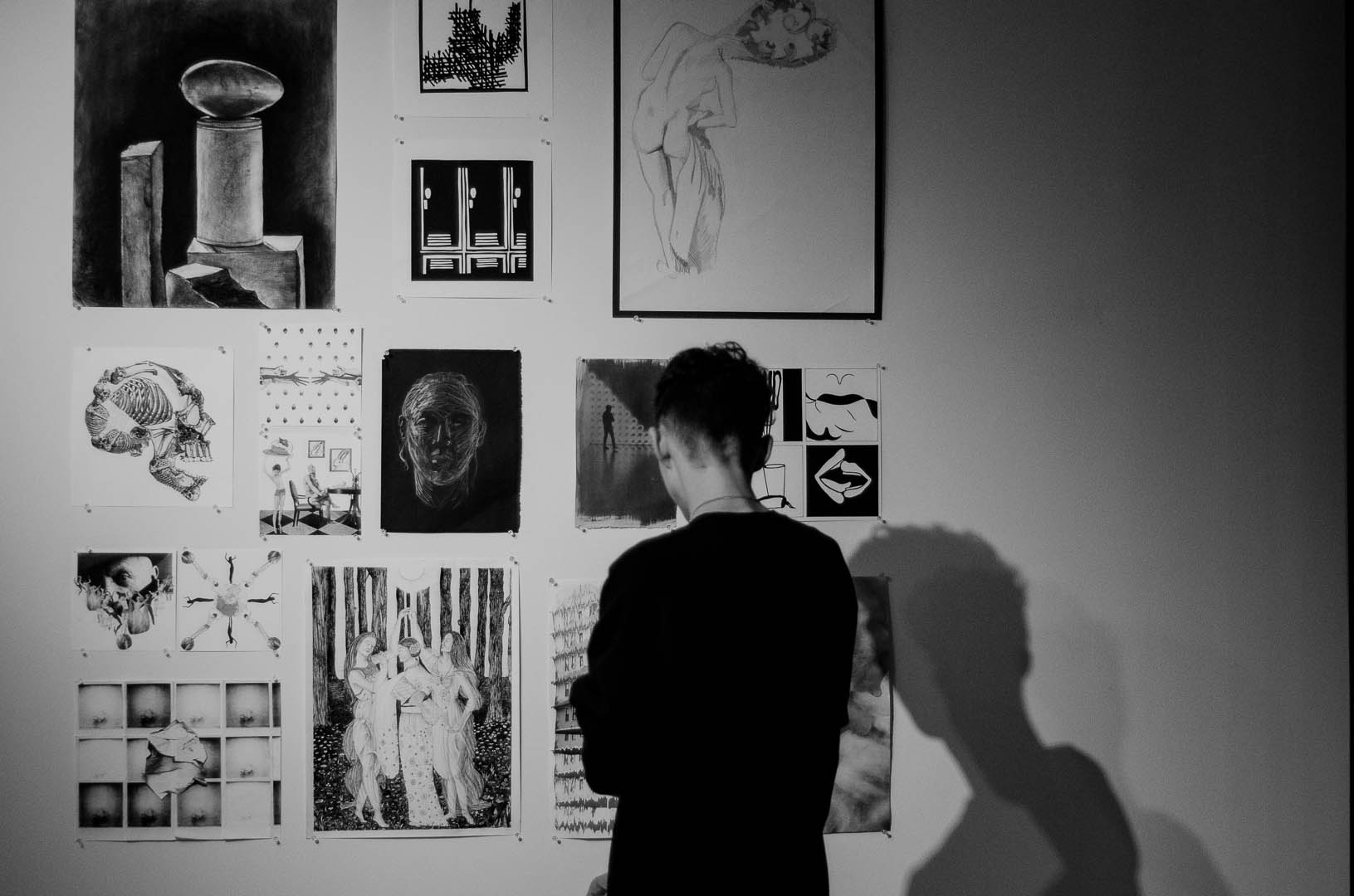 A student viewing artwork at the show. (Photo by Daniel Fremen.)