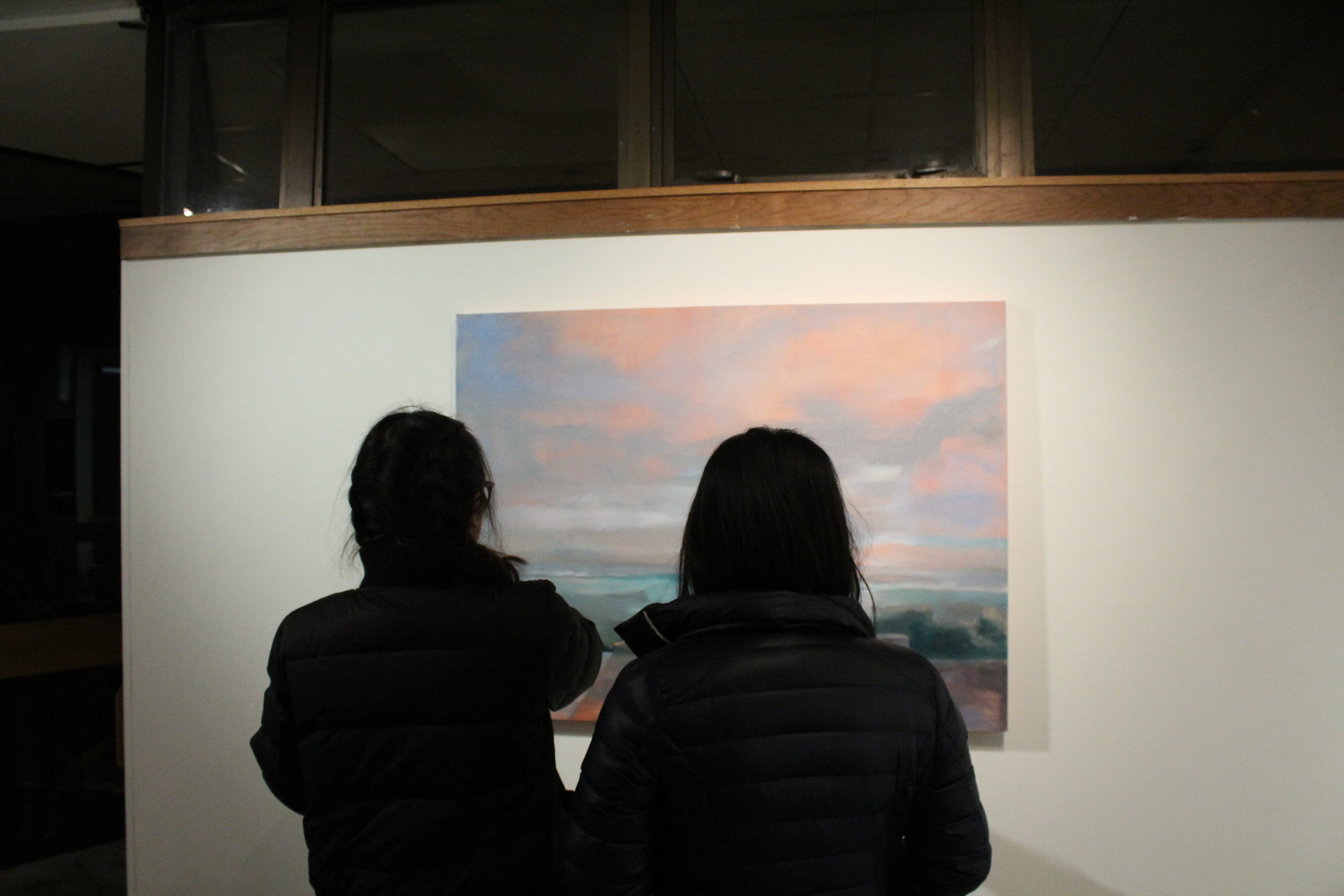 Visitors to the Kresge gallery view a piece in the  Atmosphere show. Photo by Lydia Holt.