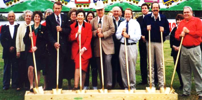 Ground breaking of the Museum building in 1998. From left are: Fred Walger, Katie Walger, Linda Wilkinson, Olive Lois Holstine (partially obscured), Travis Reese, Joan Reese, Dottie Forster, Colleen Chamberlain, Dude Callendar, (unknown obscured), Leonard Penkert, (unknown obscured), Bill Butler, Jeff Braun, Bud O'Shields, Jeanie Koval (partially obscured), and Don Wenzel.