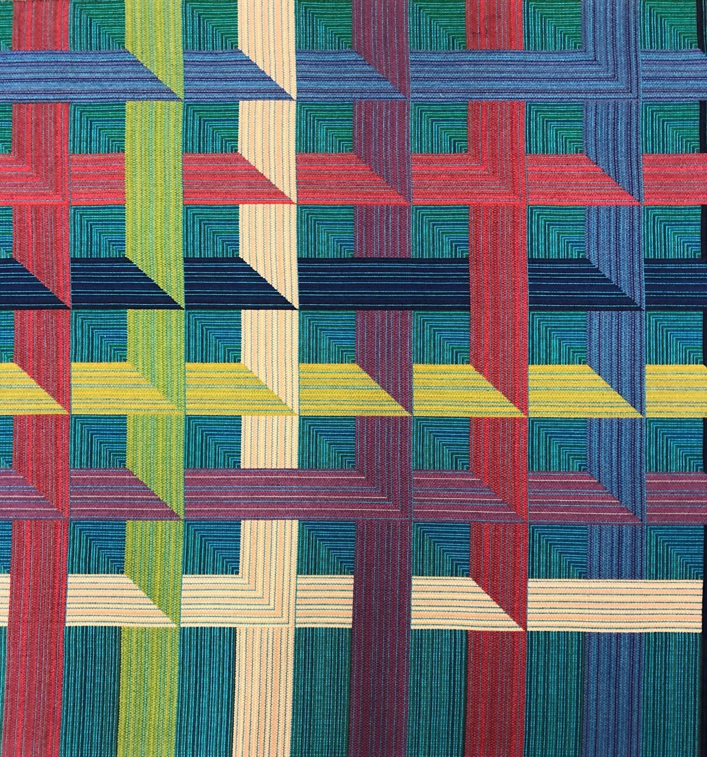 MERGING GRID  Double Beam Jacquard Woven, 2019.  Wool, rayon, nylon.    Designed and woven for Material Technology and Logistics as a showpiece for their 2019 Proposte presentation in Cernobbio, Italy. A custom planted, full width, double beam warp using 24 colors and experimenting with multiple sizes of yarns in the warp and weft. A subtle, multi-directional ombre spans the ten foot vertical repeat in the weft, and the four foot horizontal repeat in the warp. This is overlaid by a bold, multicolor abstracted weave graphic. Structural weave changes add physical depth.