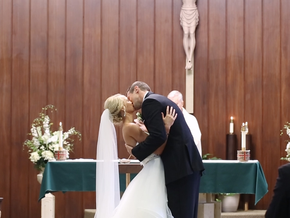 eric-emily-may-first-kiss-husband-wife-ceremony-married-dubuque-iowa