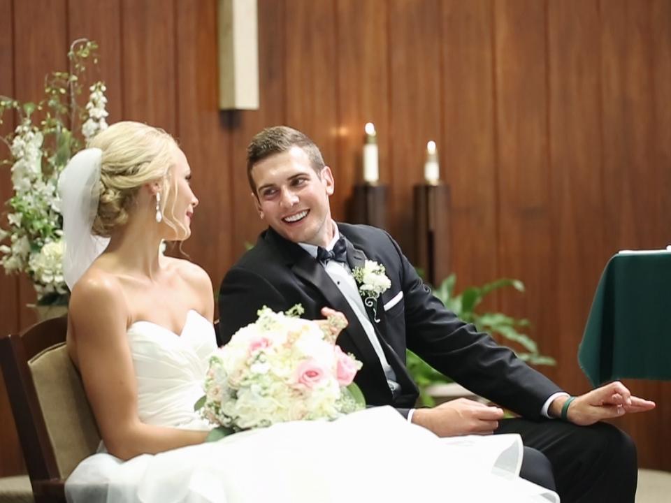 eric-may-emily-burgmeier-wedding-smiles-glances-ceremony-st-joseph-dubuque-iowa