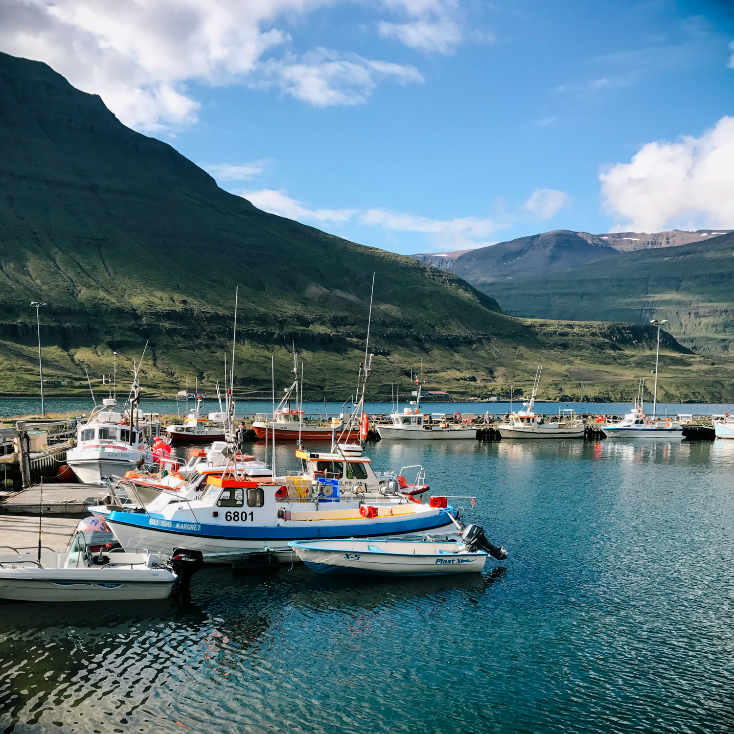 seydisfjordur-views-mountain-waterfall-town-boats.jpg