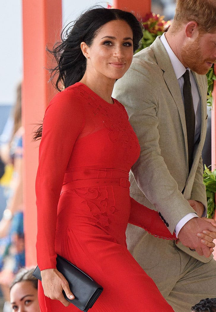 Striking in bold red, Meghan is glowing.