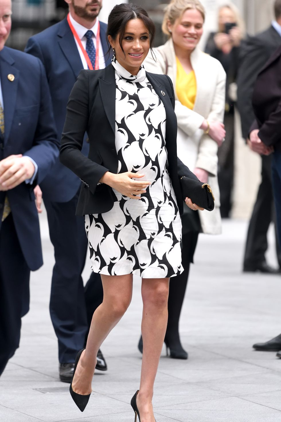 This is such a fun, youthful mom-to-be look; the graphic Reiss print punches up the classic McQueen black blazer. Guessing the length was not palace approved.
