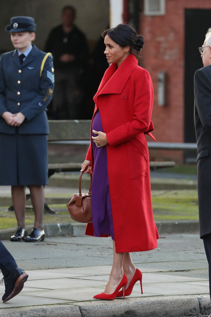 Quite the opposite of what I usually think of Meghan style! Bright red and purple combo to brighten a dreary day.