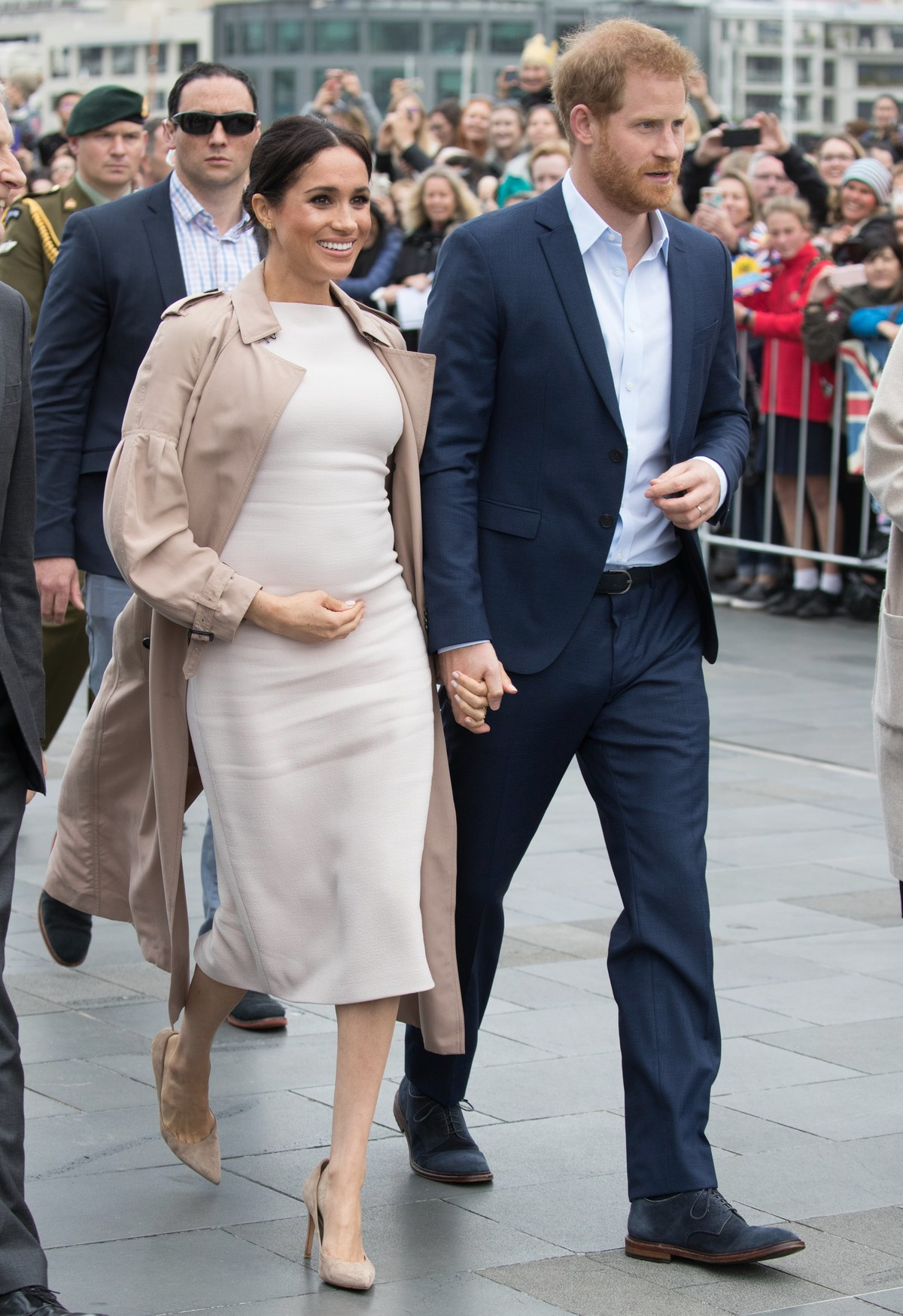 Combining two of Meghan's favored looks, this tone-on-tone ivory Brandon Maxwell dress under a Burberry trench, with the perfect nude suede pump…perfection!