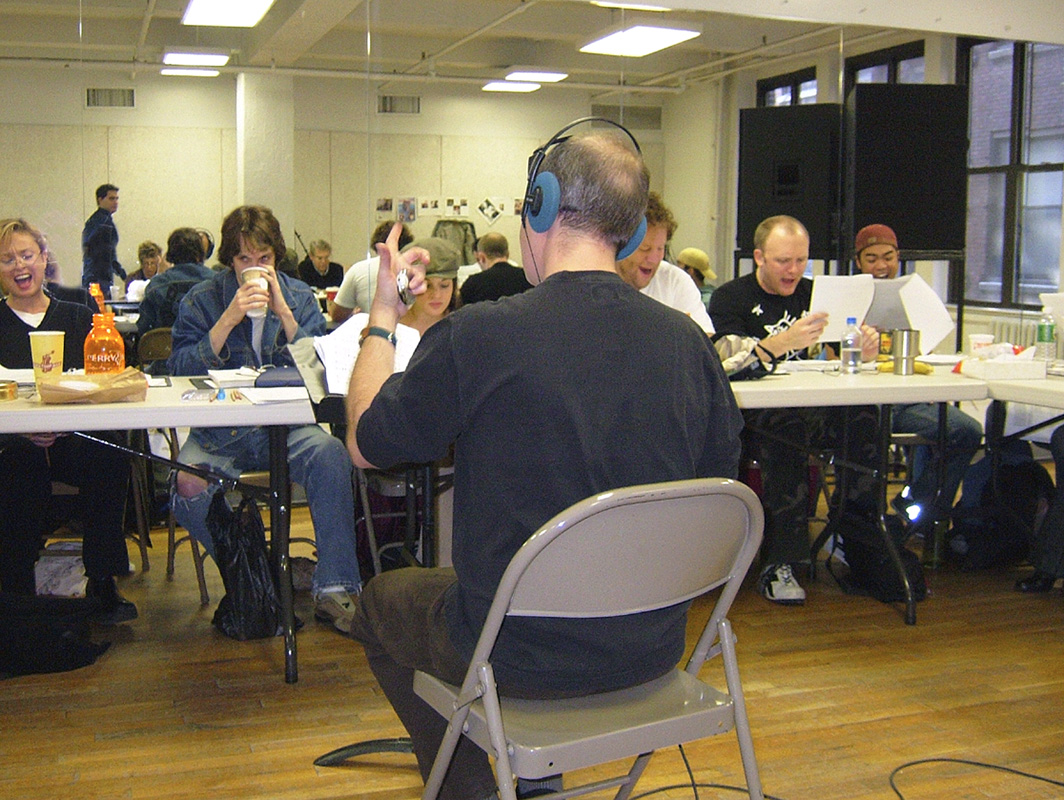Leading the cast in a table reading.jpg