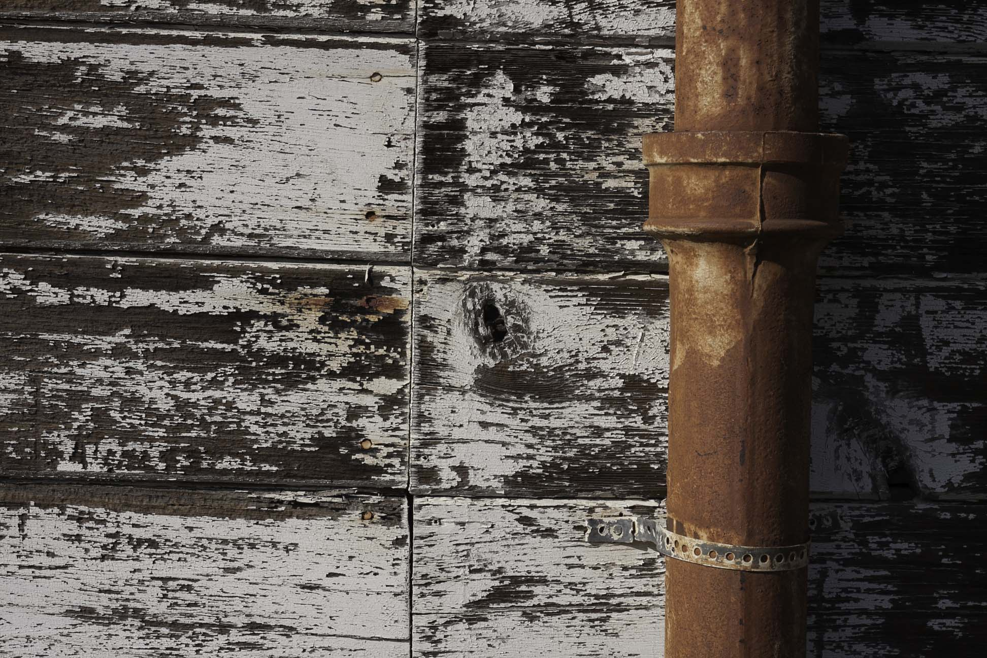 rustic wall with rusty pipe.jpg