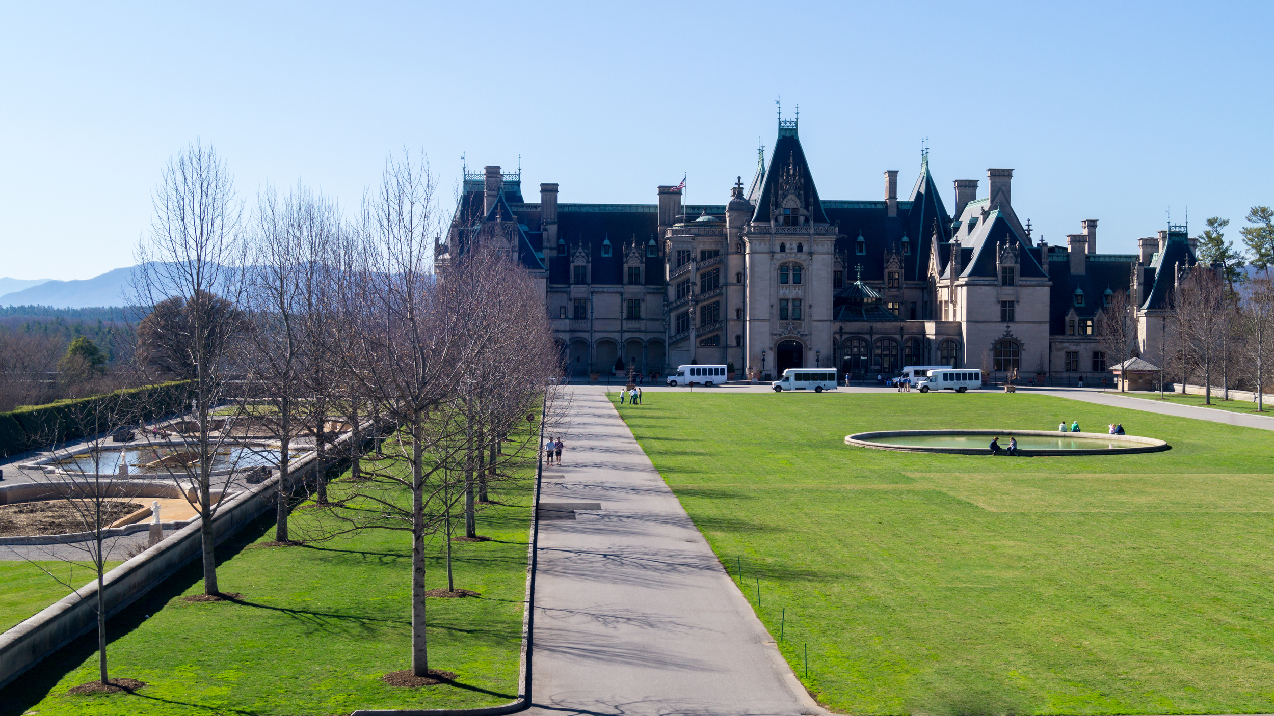 A shot of the entire area in front of the Biltmore Mansion plus the mansion in the background.