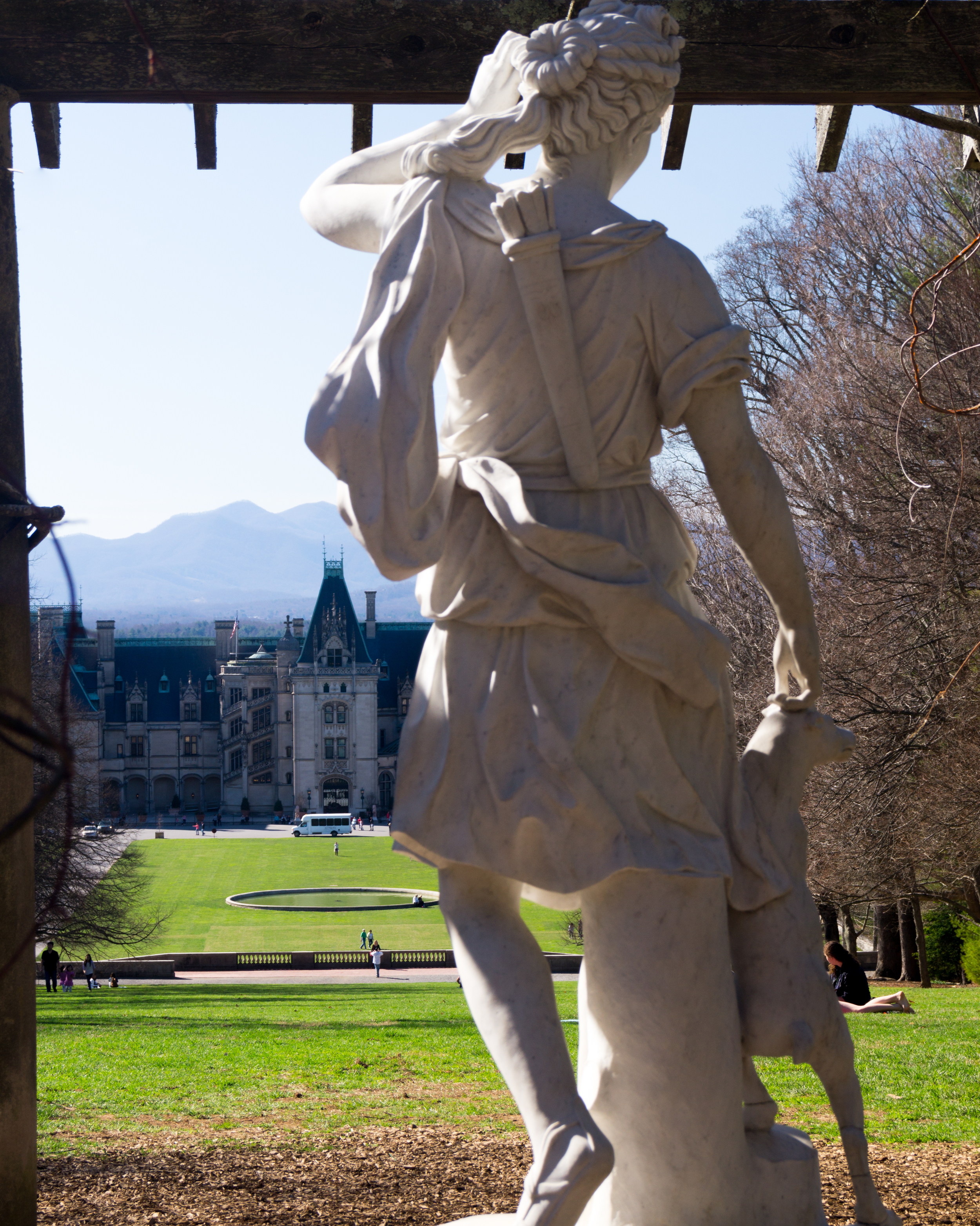 There is a large stretch of grass leading from the mansion up a hill to this statue.