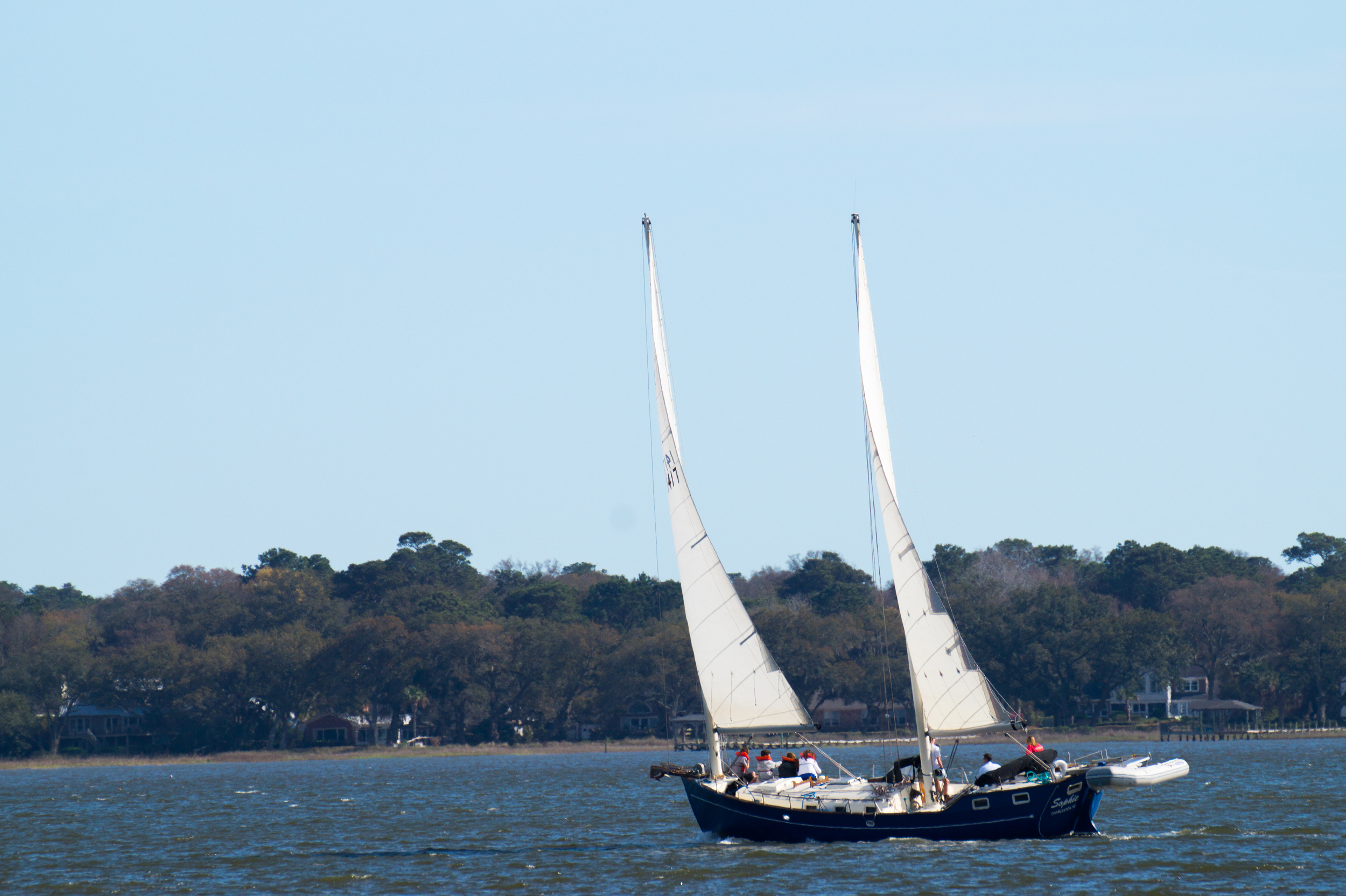 A sailboat in Charleston's Bay during a bright and sunny day.