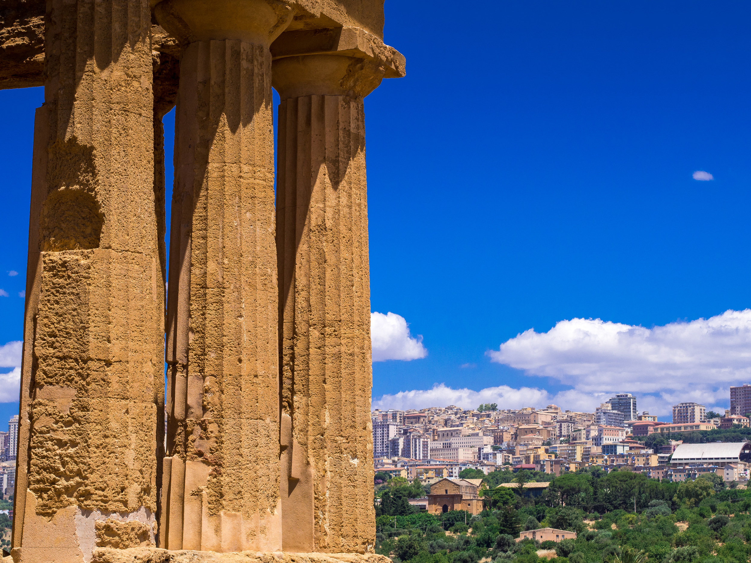 Pillars of Concordia with Agrigento in the background.