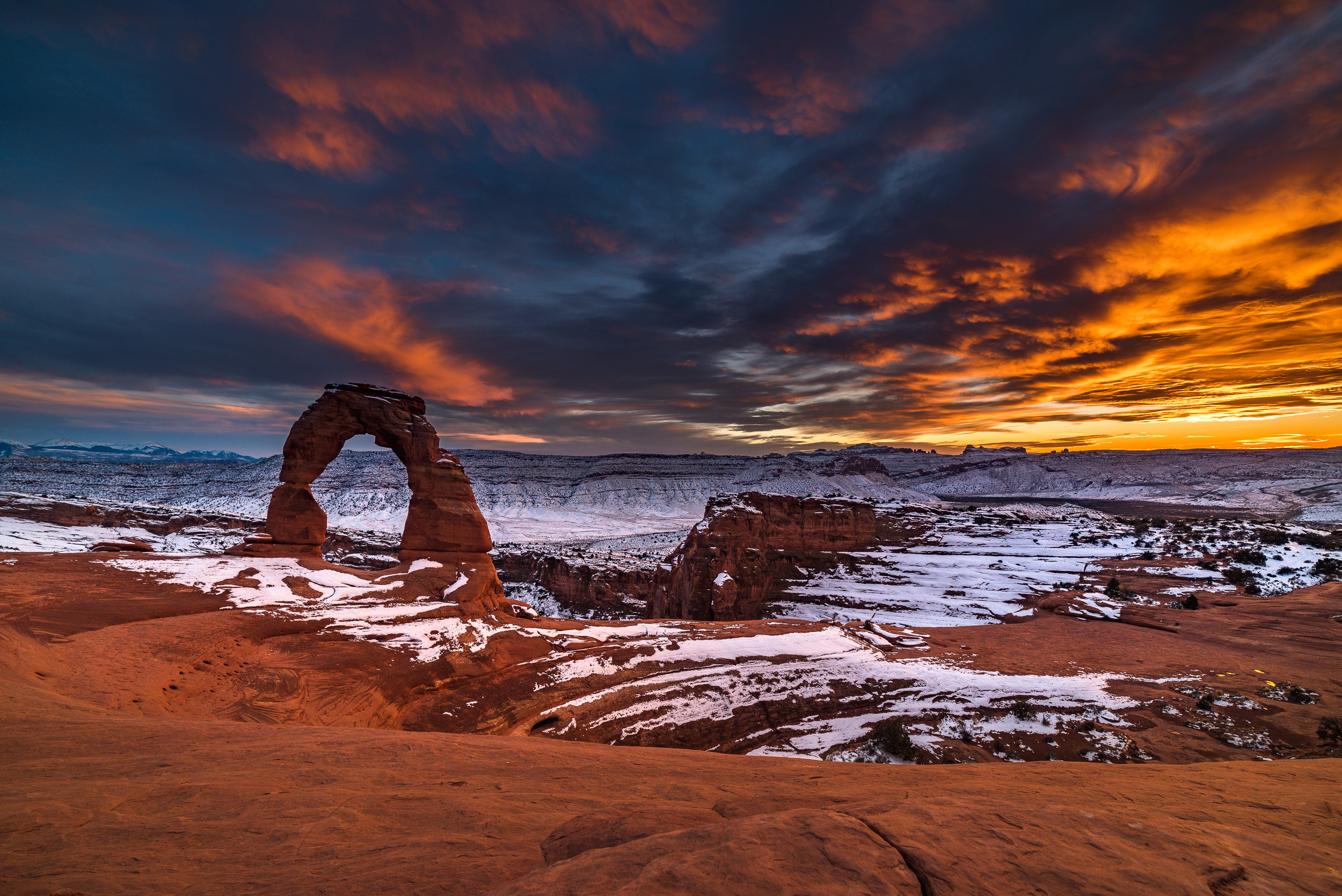 delicate arch sunset winter snow