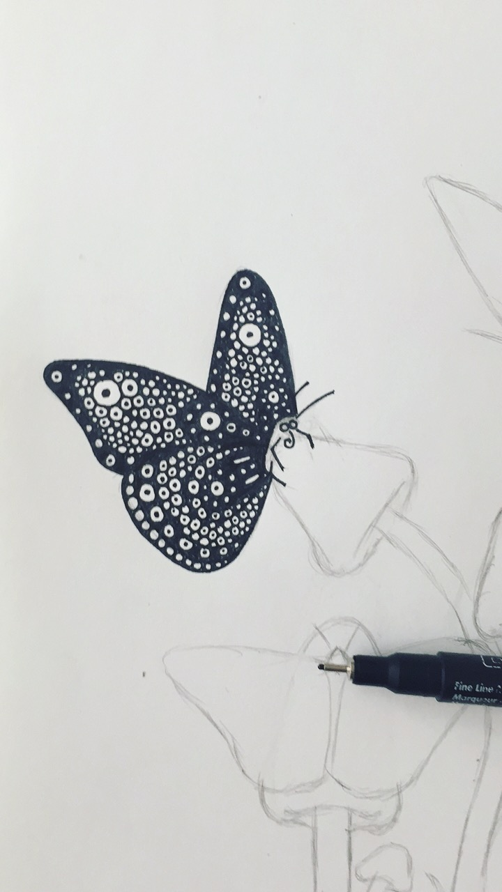 Inking one butterfly at a time.