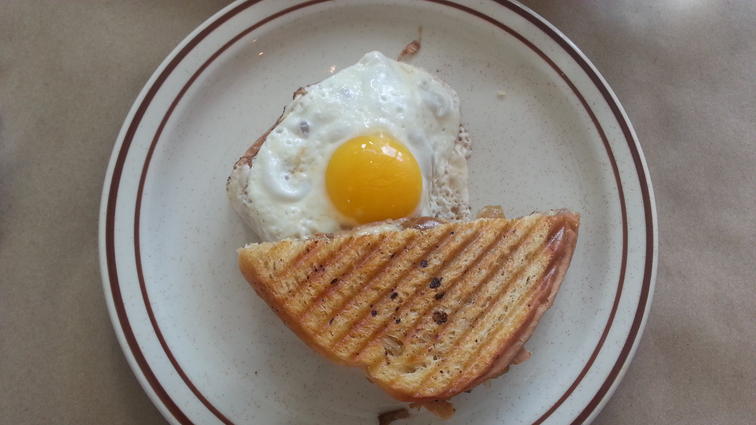 Pulled pork + caramelised apples + cheddar + sunny side-up egg grilled cheese