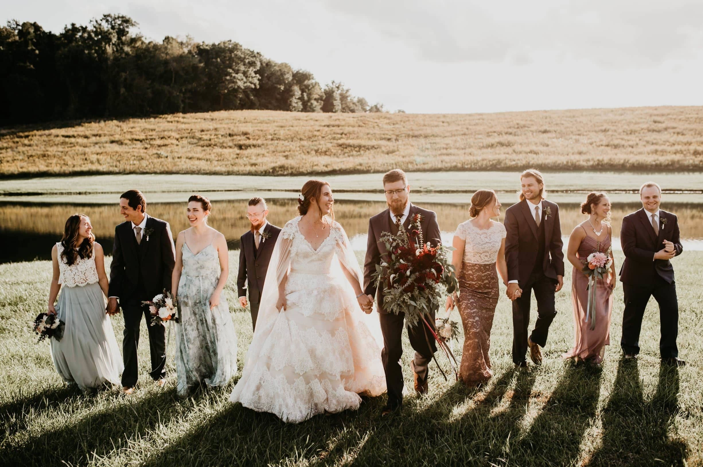 em and tyler bridal party walking.jpg
