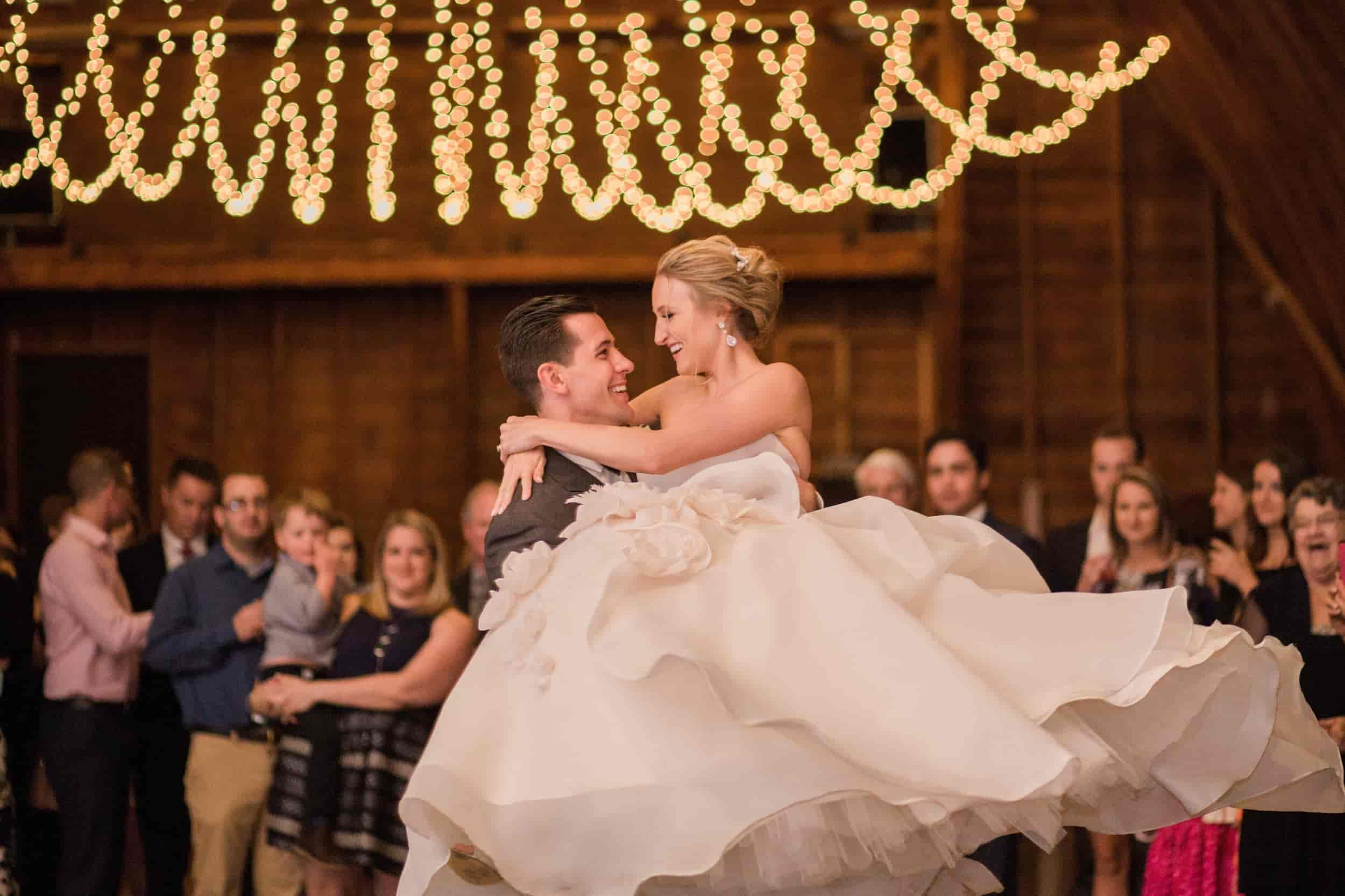 barn wedding bride and groom dancing under string lights.jpg