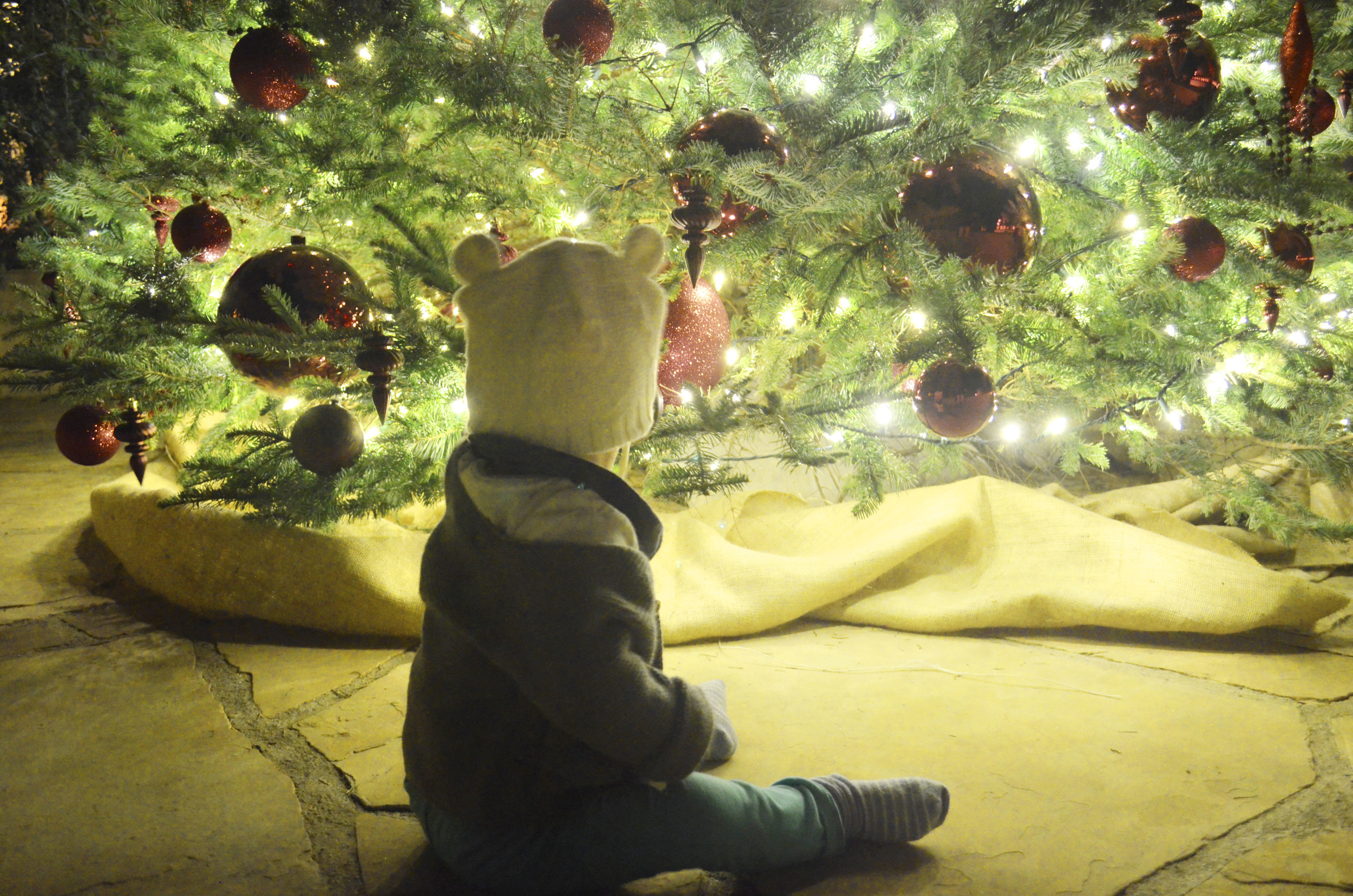Baby sitting under christmas tree | Holiday Traditions to do with your family