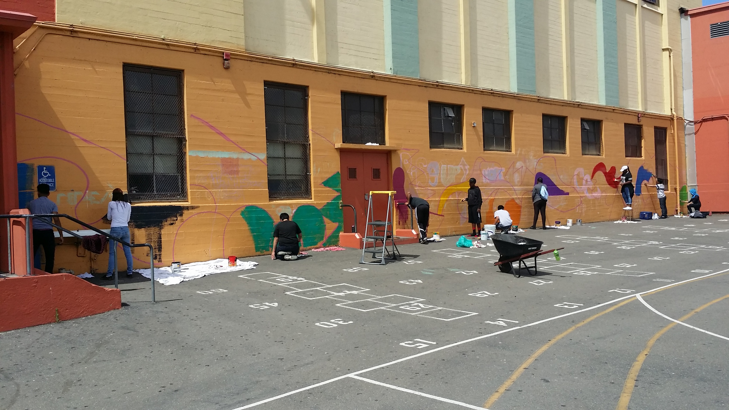 Students began painting the wall under my guidance.
