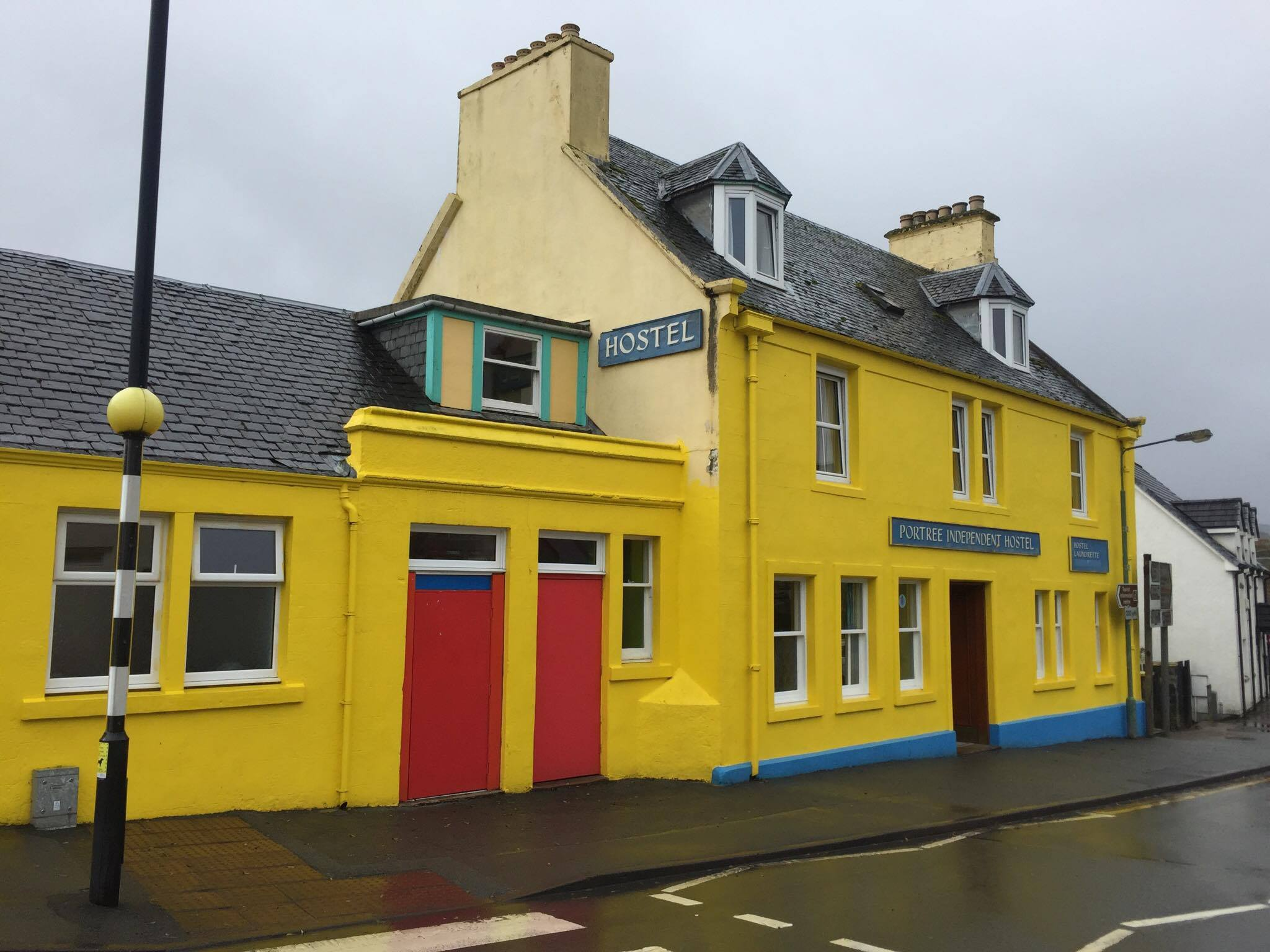 Our bright yellow hostel in Portree, iPhone