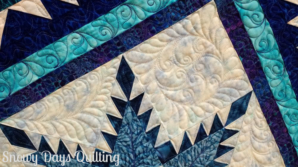 quilted feathers on feathered star quilt