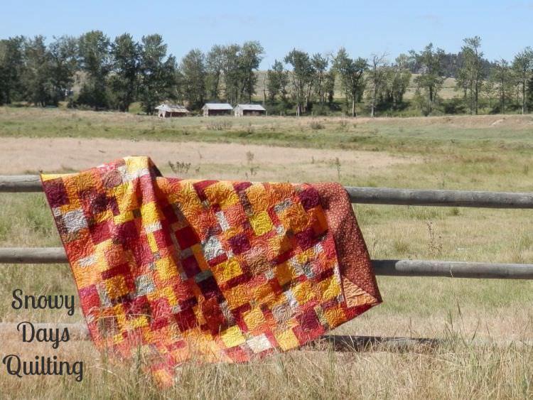 Linda's fiery hug batik fall disappearing nine patch quilt