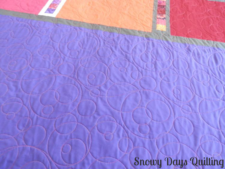 Roller Rink quilt back champagne bubbles quilting