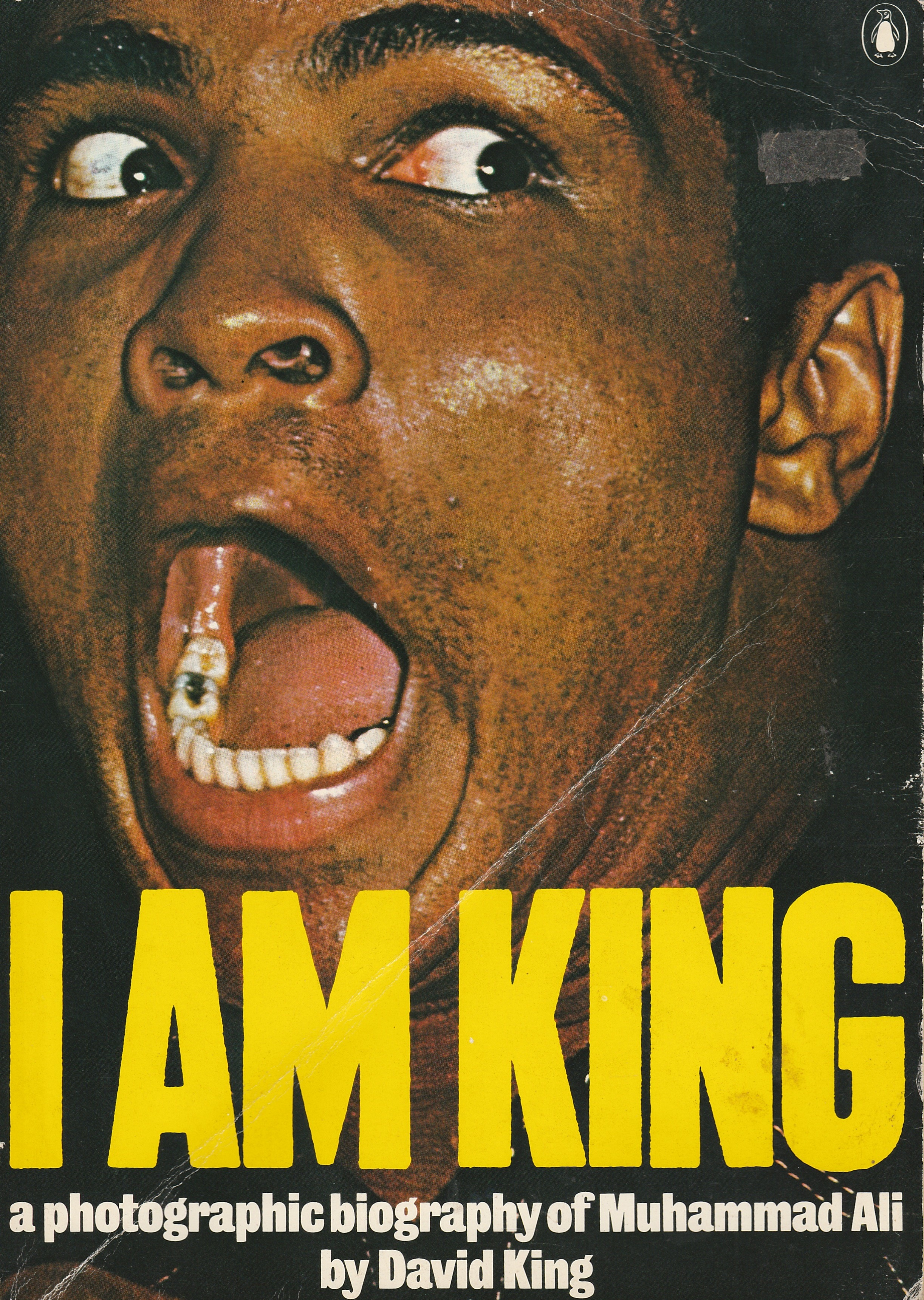 """""""King was born in 1943, and studied at the London School of Printing and Graphic Arts (now London College of Printing) under Robin Fior, who describes King's approach as 'compare and contrast as a political stance'. As art editor of  The Sunday Times Magazine  from 1965-75, he collaborated with art director Michael Rand to create the new language of the supplement: features sporting dynamic picture cropping and processed graphic effects gave the magazine a cinematic feel. King forged important friendships with other  Sunday Times  contributors. With Francis Wyndham he compiled the first pictorial biography of Leon Trotsky (1972). King began supplying his own pictures to the  Sunday Times  , and an assignment with Muhammad Ali in 1974 resulted in the book  I am King  .""""   Christopher Wilson,  First published in   Eye   no. 48 vol. 12, 2003"""