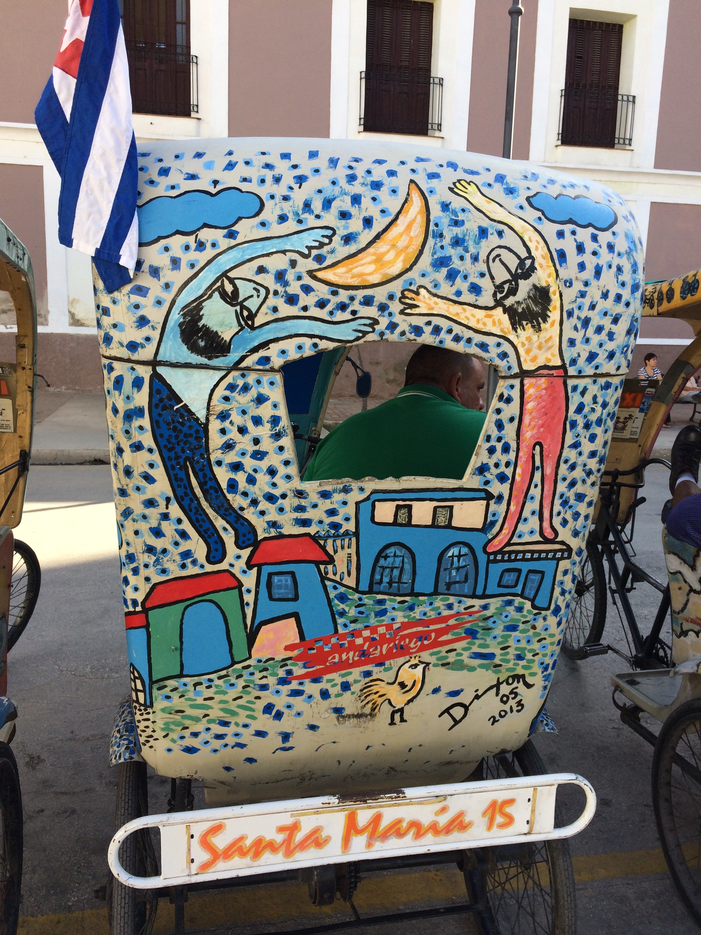 """On our first morning, we were transported in a fleet of """"bici-taxis"""" decorated by local artists to visit several galleries."""