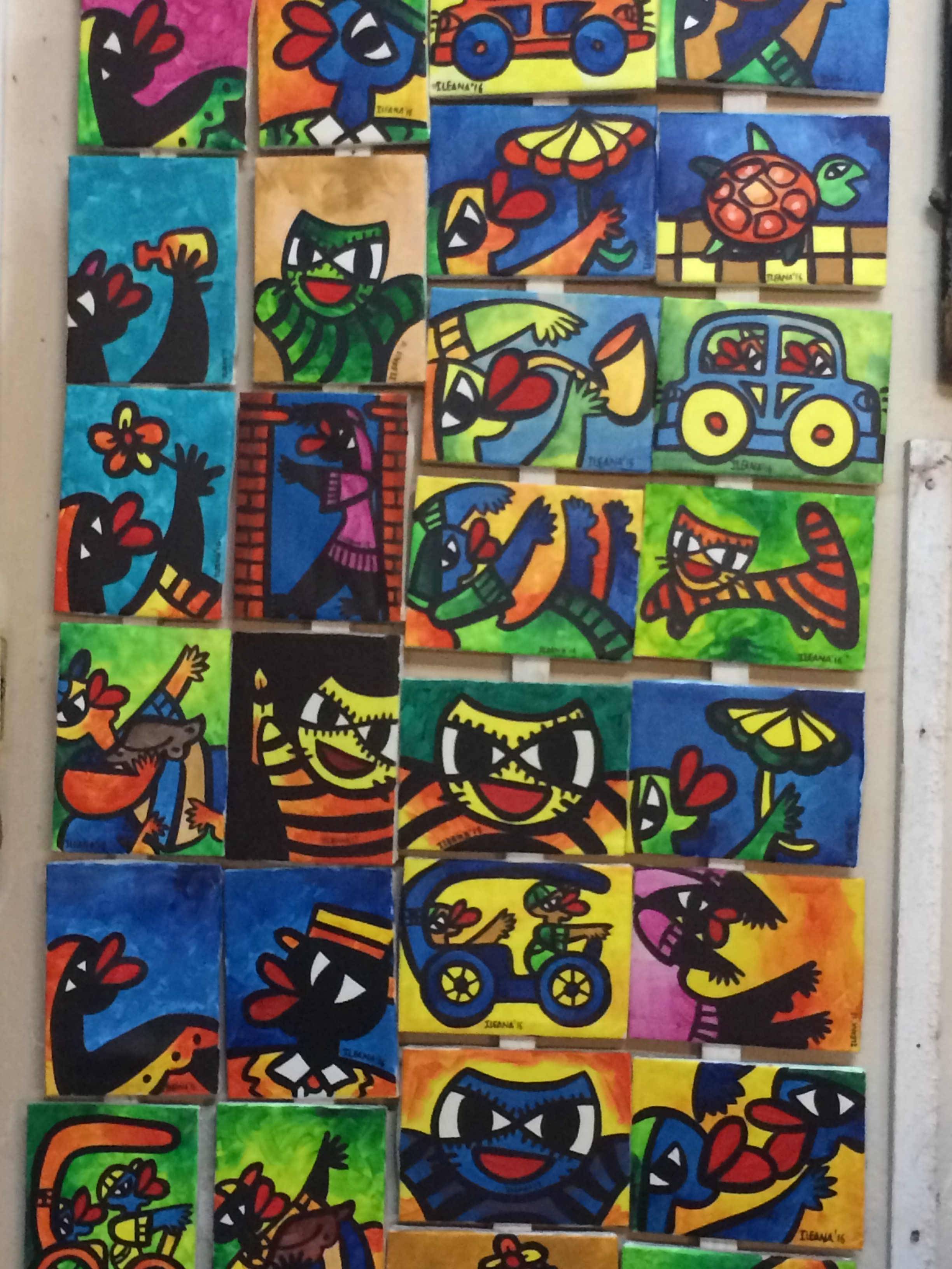 We saw this artist's cat faces in more than one mural (see below)