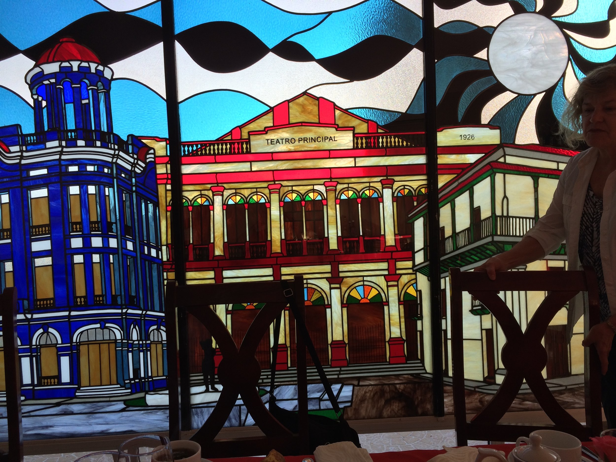 Breakfast room of our Camagūey hotel had stained glass featuring scenes of the city
