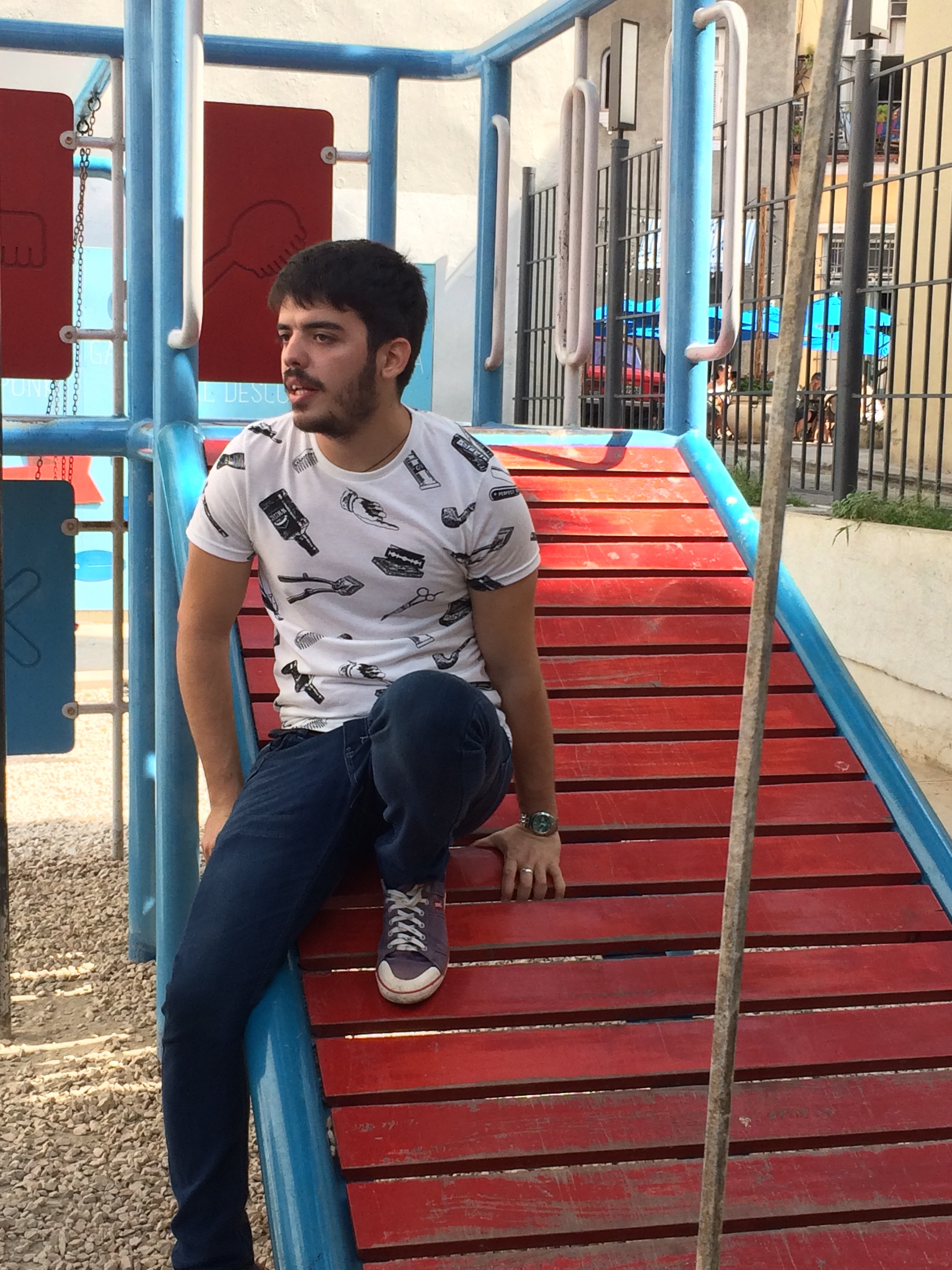 Carlos, relaxing on a play structure at the Barber's Park, said his mother gave him the shirt