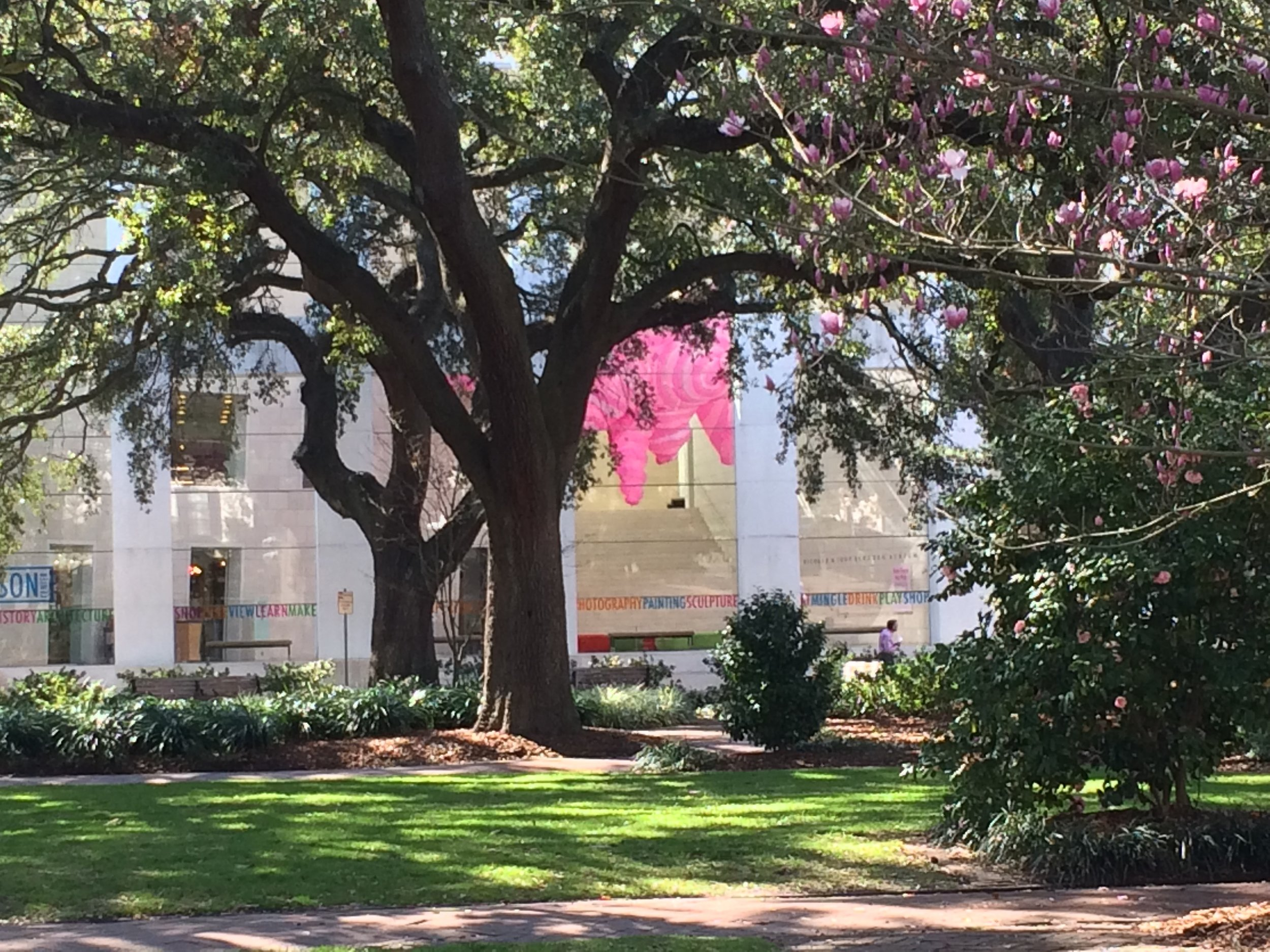 """A glimpse across the square of an installation called """"Hot Pink"""" in the atrium lobby of the Jepson Center for the Arts, one of the Telfair Museums."""