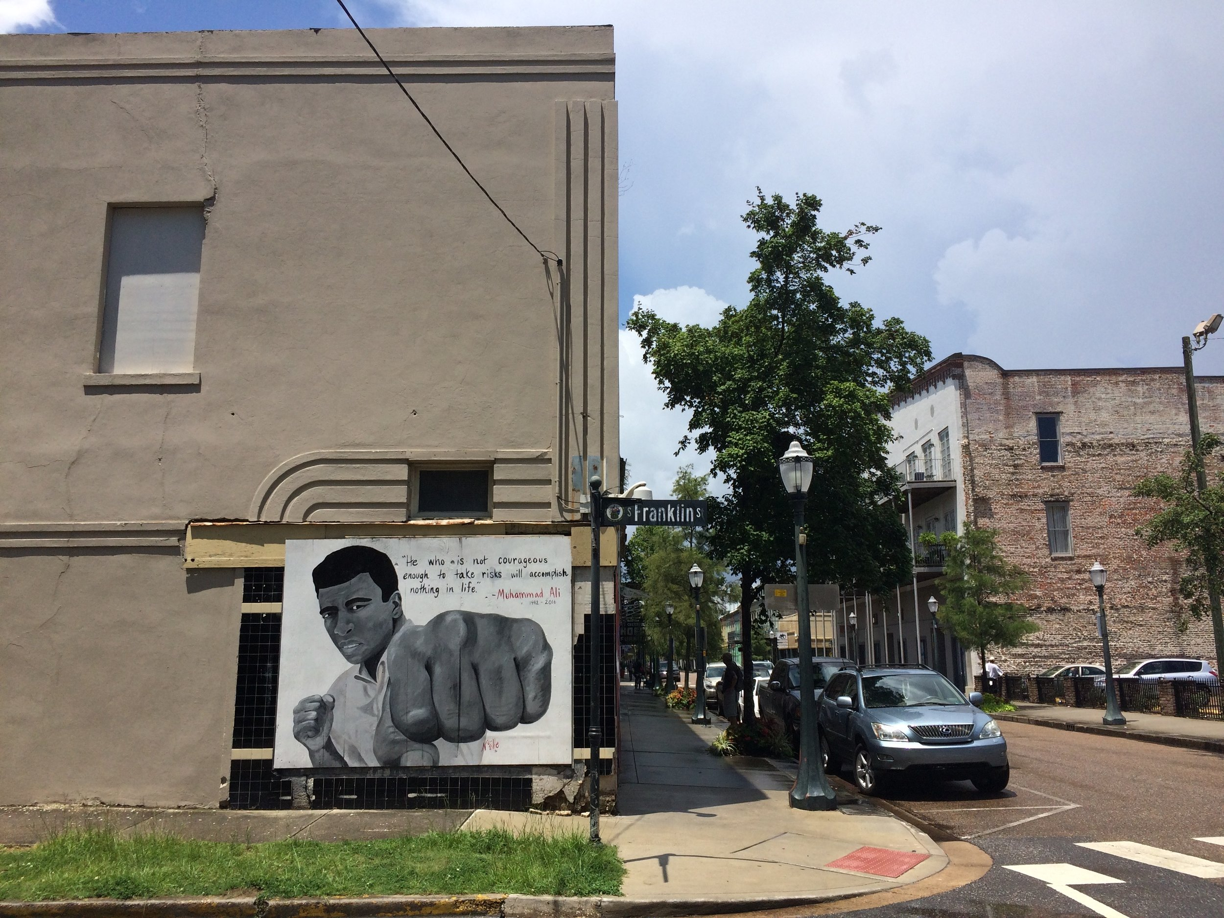 Downtown Mobile streetscape features several murals.
