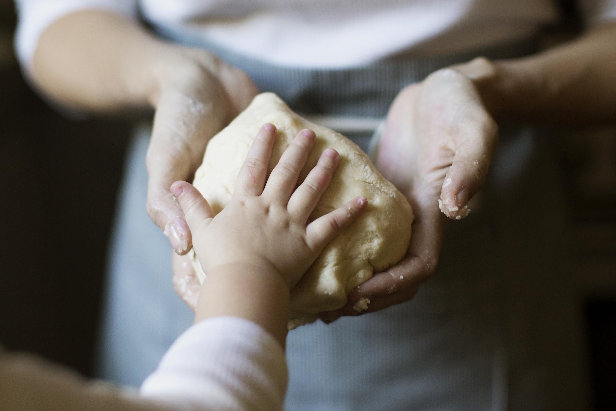kids hands cookie dough