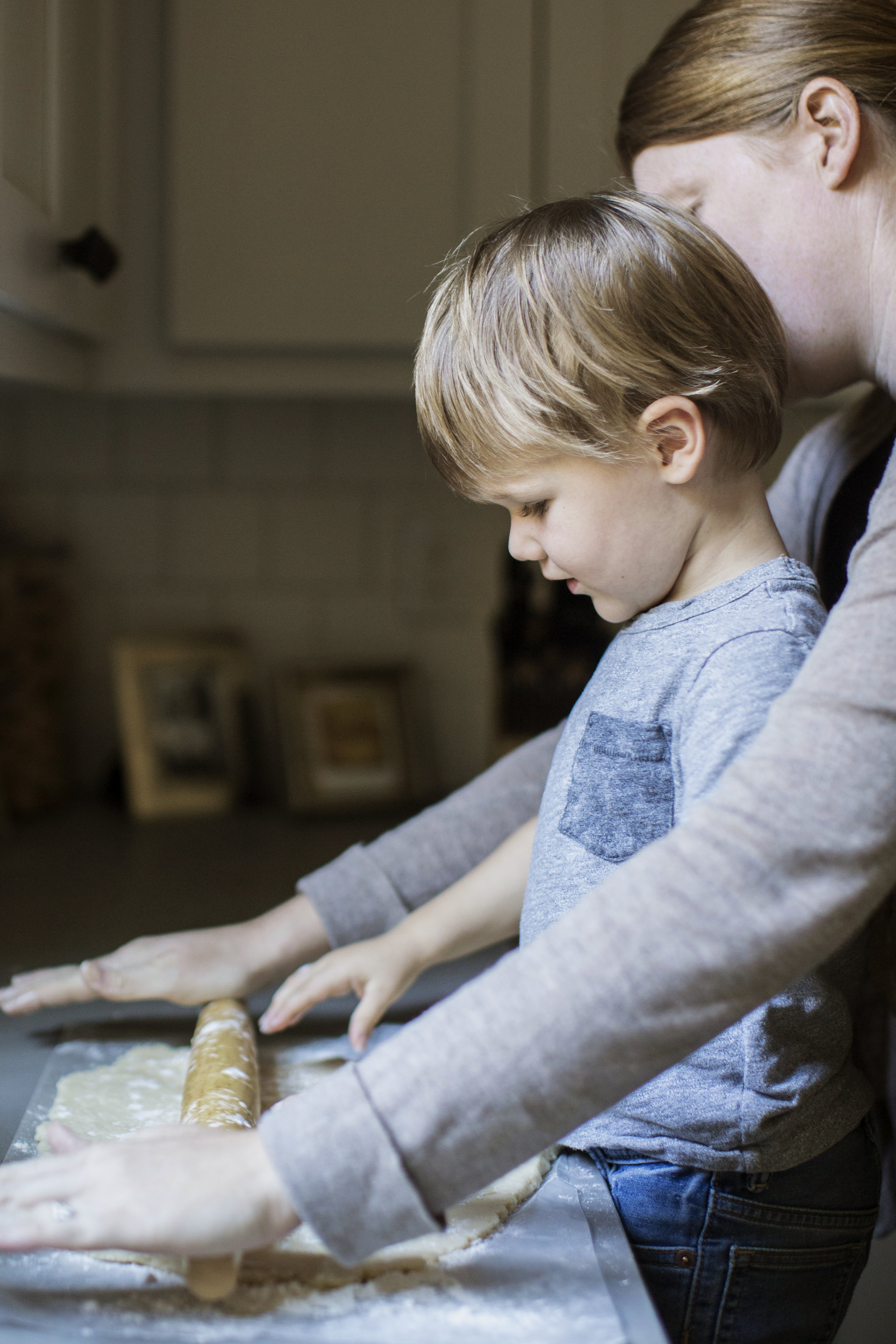mom and son rolling pin with dough