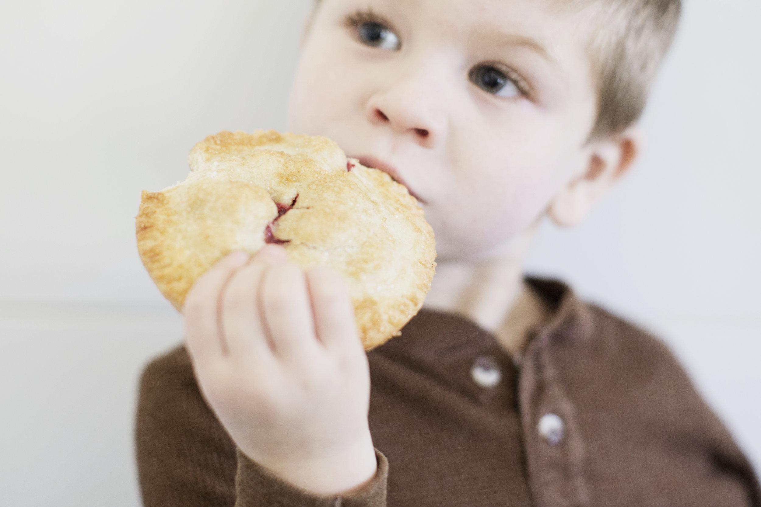boy eating cranberry handpie Thanksgiving dessert