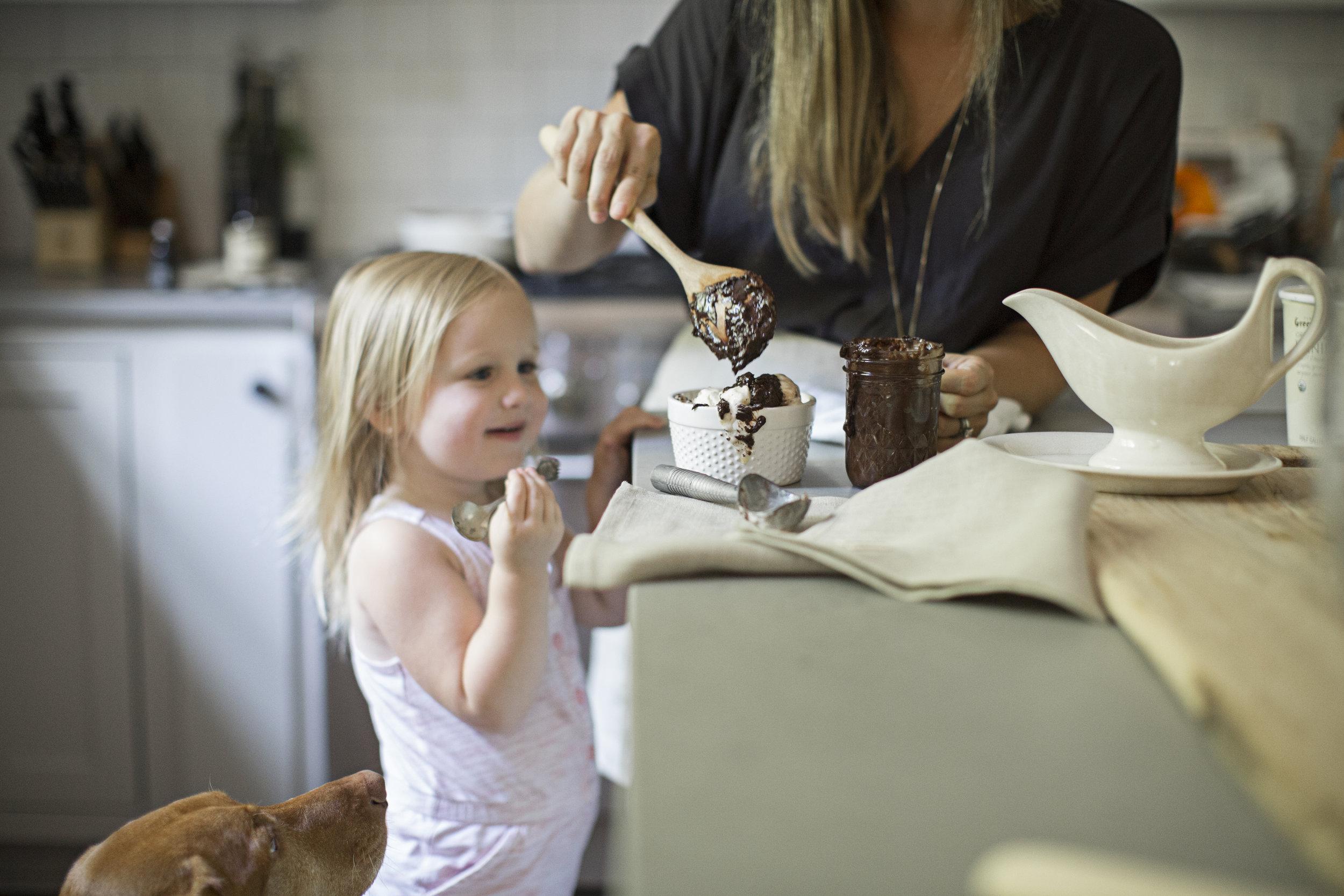 little girl making ice cream sundae