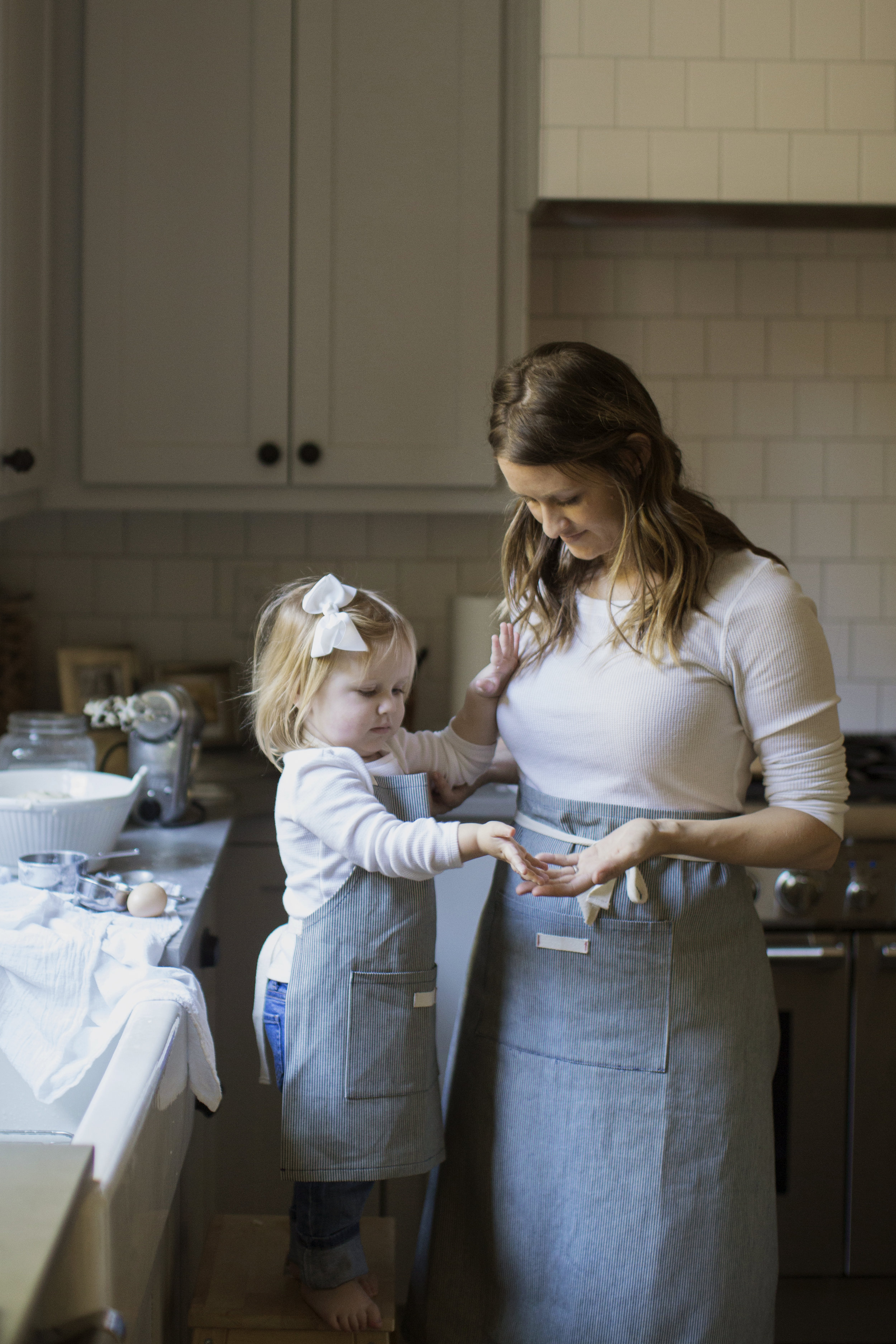 mother and daughter aprons in the kitchen